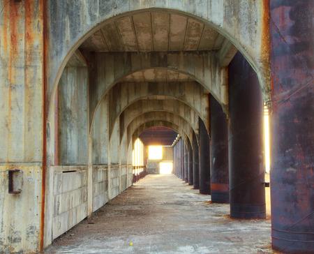 corridor of concrete pillars with perspective depth