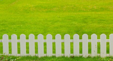 palisade: Stock Photo - wooden fence in the grass.