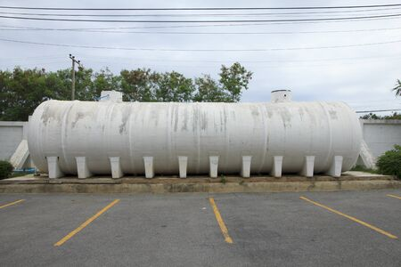 Water tank off the ground on concrete supports