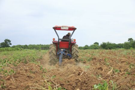 horticulturist: Farmer was drove tractor plowing the soil to picup cassava
