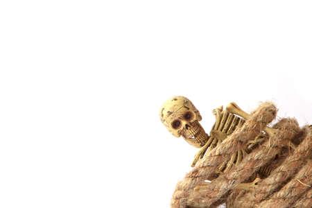 nightmarish: Human skeleton with rope on white  background