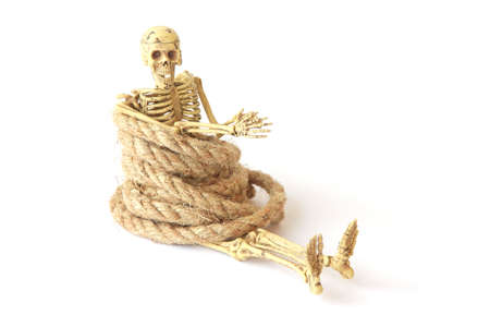 nightmarish: Human skeleton with rope on white  background