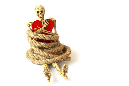 dreadful: Human skeleton with rope on white  background