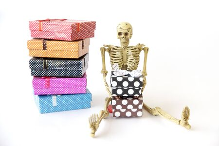 pull toy: Human skeleton Sit on the floor with gift box on white background