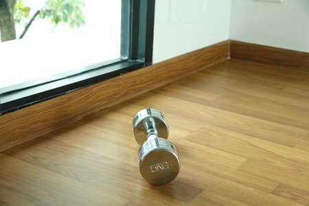 dumbell: steel dumbell on the wooden floor