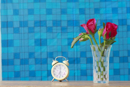 colorful still life: Colorful still life with roses in glass vase Stock Photo