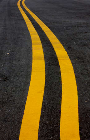 median: Double Yellow Line Median On Isolated Black Concrete Road In Color Stock Photo