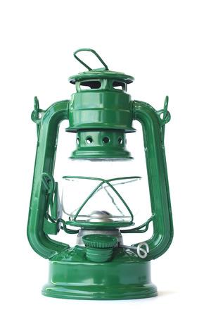 cave exploring: vintage green kerosene lamp on white