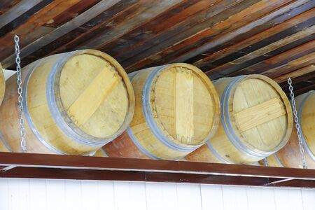 ferment: Close up of wooden wine barrel in wine cellar Stock Photo