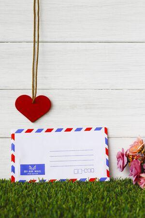 old envelope: Old air envelope on wooden texture