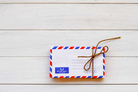 envelope: Old air envelope on wooden texture