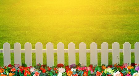 stock photo: Stock Photo - wooden fence in the grass.