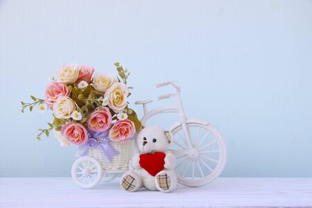 Plastic Floral Bouquet of Different Flowers on white table Background