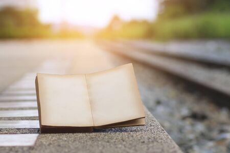 open book on the railroad tracks, with a filter effect