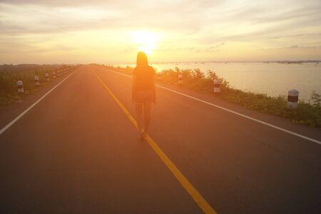 walking away: Walking away in summer sunset