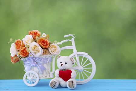 decorated bike: Old bicycle with baskets of bright flowers.