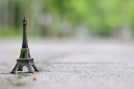 A statue of the Eiffel Tower in bronze. Shallow depth of field  background and copy space provided.