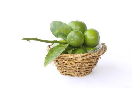 Lemons in basket isolated on white background