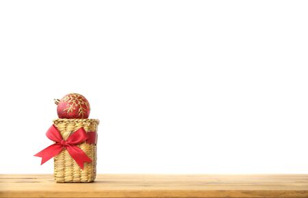 Christmas Card with Composition from Pink Natural Balls, Pine Cones, Beads on Wooden Background