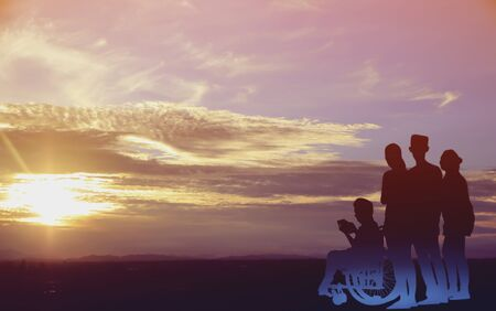 Silhouette family with wheelchair on sunset Stock Photo