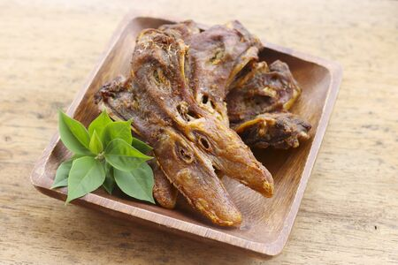 fried platypus on the basket.( fried duck mouth)