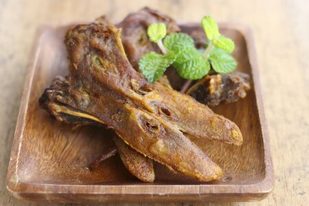 platypus: fried platypus on the wood plate.( fried duck mouth)