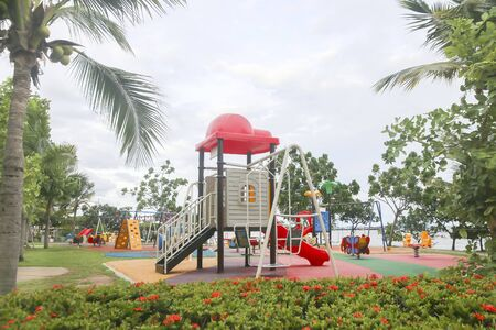 Children kid playground for leisure and recreation activity with toy and slider leftover in the park in childhood color style Stock Photo