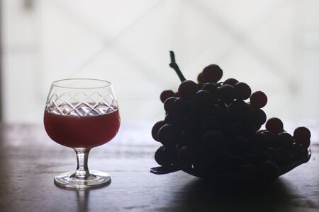 Glass of Grape Juice smoothie on wooden background