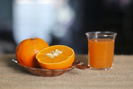 Oranges and juice on black background Stock Photo