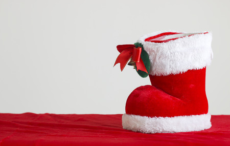 golden section: Red Santas boot with copyspace isolated on white background