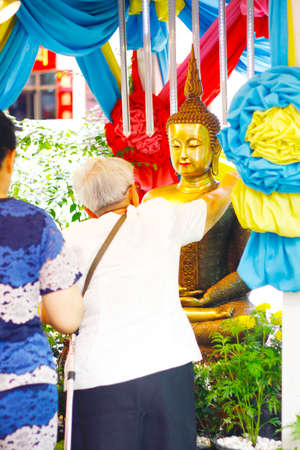 pouring water to buddhist priest and asked for blessings on Songkran festival in temple,Thailand Stock Photo