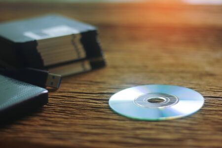 different computer storage devices for data and information including a CD-DVD, floppy disc, USB key, compact flash card Stock Photo
