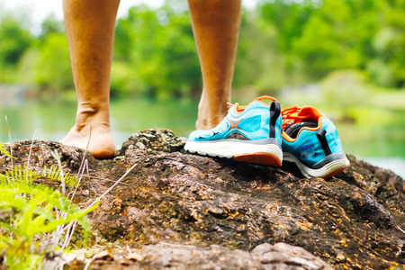 Blue shoes on mountain landscape Stock Photo