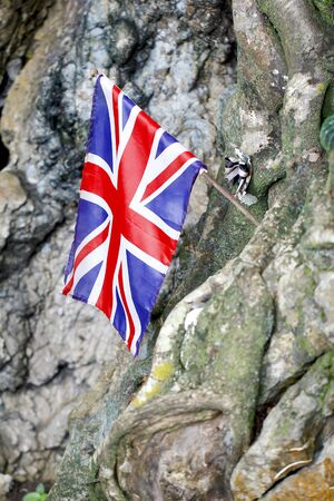 Peoples laid United Kingdom flag, bead necklace and the boomerang to commemorate POWs at Hellfire Pass of Death Railway, Kanchanaburi, Thailand