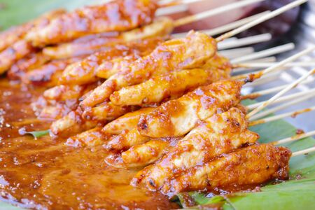 Satay thai food ,pork grill with onion red sauce