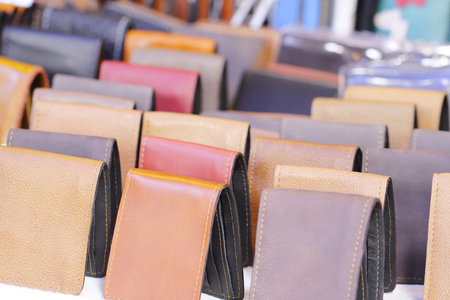 Numerous leather wallets in different colors werewolf Placed for sale Stock Photo