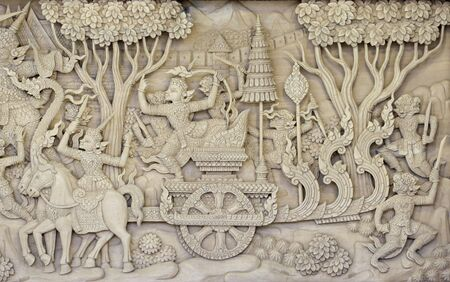 a traditional sculpture on an old wooden door Stock Photo