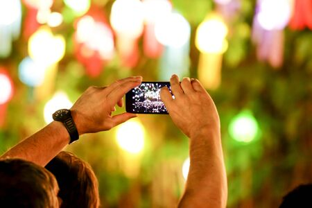 newsroom: Capture video in festival at the phone camera in a bright lamps Stock Photo
