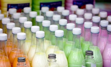 Plastic liquid bottles of different colors background Stockfoto
