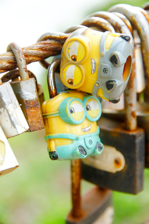 CHANTHABURY,Thailand - JUNE 24, 2017: Key Minions hanging on Wire. produced by Illumination Entertainment for Universal Pictures.