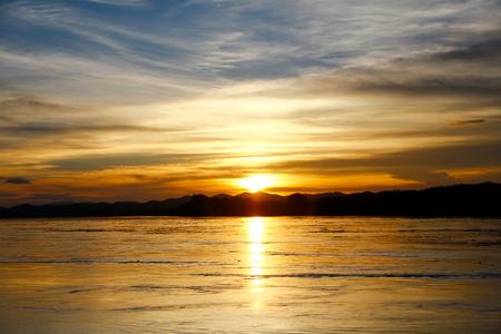Sunset sky over water landscape. Sunset sky clouds over sunset river. Sunset river water view