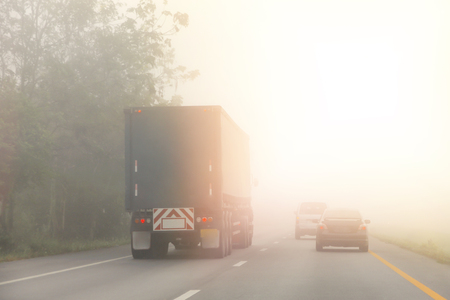PM2.5 Unhealthy air pollution dust smoke road with detail of car light.dangerous haze and fog.car or dangerous winter transportation concept. Stok Fotoğraf