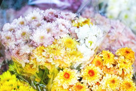 Several bundles of flowers for sale. Spring meadow flowers.