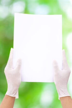 aseptic: White paper in aseptic hand and green background