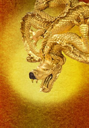 The art of golden dragon with gold paper photo