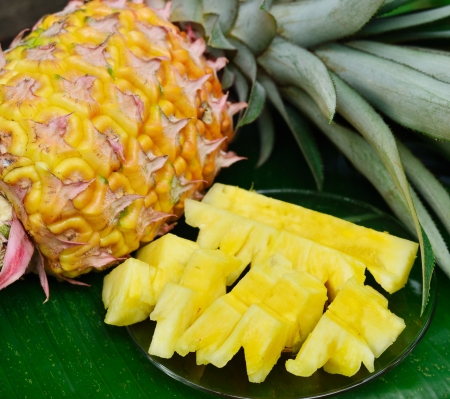 chunk: Pineapple slice and fruit on green background