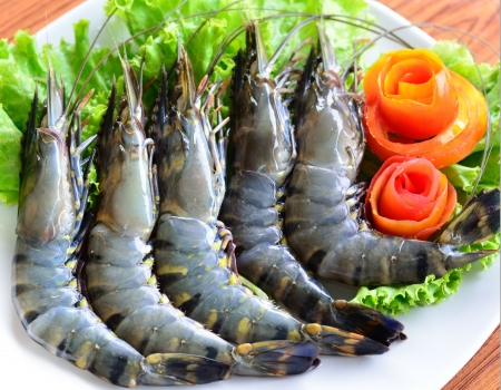 Tiger prawns on a white plate Stock Photo