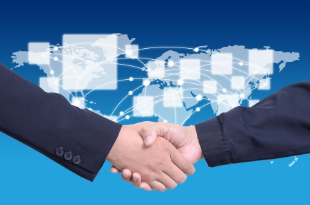 business people shaking hands with social network