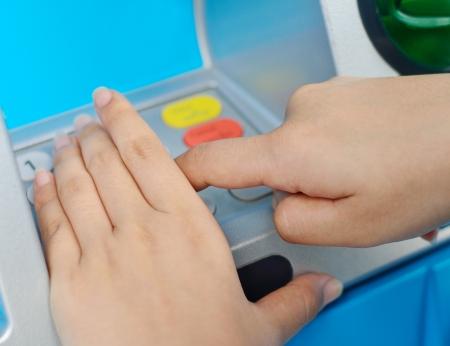 pin code: Human hand enter atm banking cash machine pin code