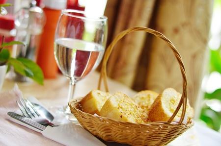 Garlic bread on basket photo